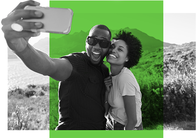 Couple taking a selfie after completing time-off requests on the Paycom app.