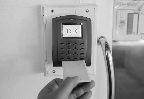 Person clocking in with a Paycom Time Clock Terminal.